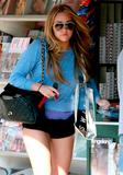 Amanda Bynes show off her legs wearing ultra short shorts showing her perfect ass at newsstand in Los Angeles - Hot Celebs Home